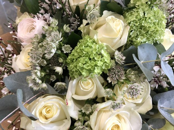 A beautiful bouquet of the season's finest fresh blooms dressed with complementary foliage.